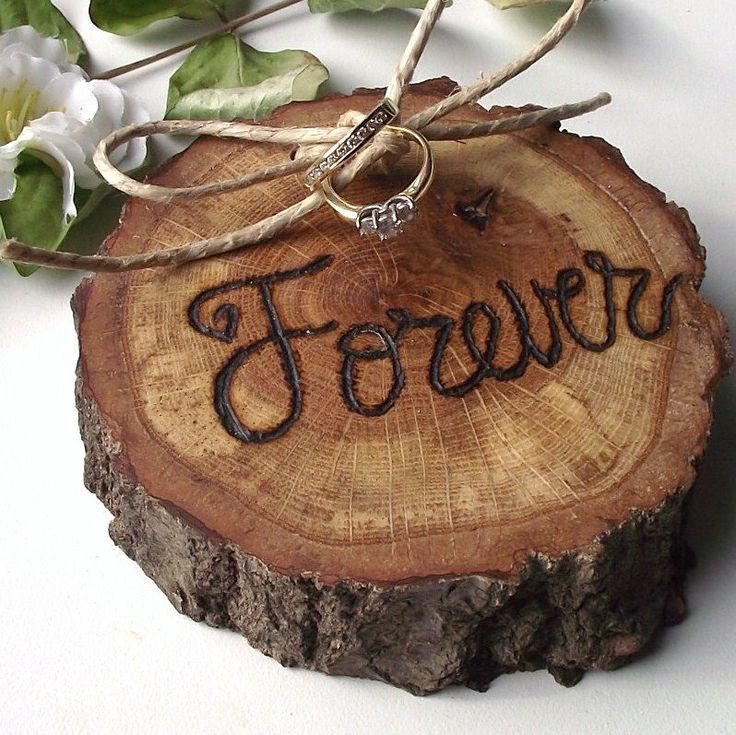 rather than going for a traditional pillow or basket, how about a rustic and natural addition, like this Ring Bearer Wood Slice: