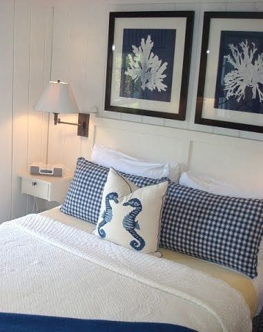 Coastal bedroom with gingham pillows on the bed
