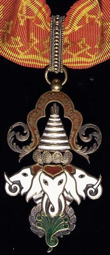 LAOS. Order of the Million Elephants and Parasol, Commander's Neck Badge, Instituted 1844. (Effective date 1920). Silver gilt and enamels, 62 x 38mm. Three white enamel elephant heads and 7-headed serpent under parasol. Cravat loop connects to red moir ribbon with golden geometric patterns on each margin.