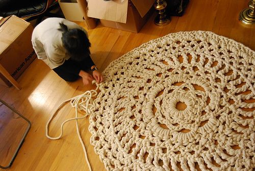 CROCHET | Crochet Doily Rug | This lady hand crocheted (no hook, just hands) the giant doily rug with what looks like rope. Whoever said that doilies had to be cute little dainty things for dinning room tables? I dare someone to take a doily pattern and make a giant rug with it!