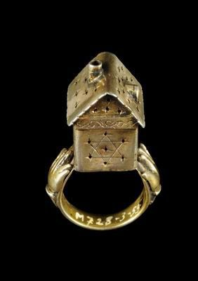 A possibly nineteenth-century Austrian gilt-silver Jewish wedding ring incorporating a symbolic house with a star of David. (The Israel Museum):