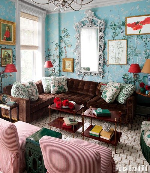 I don't think I would use the wallpaper but the shade of blue in a smaller dose with the brown sofa would be beautiful.  Gorgeous room