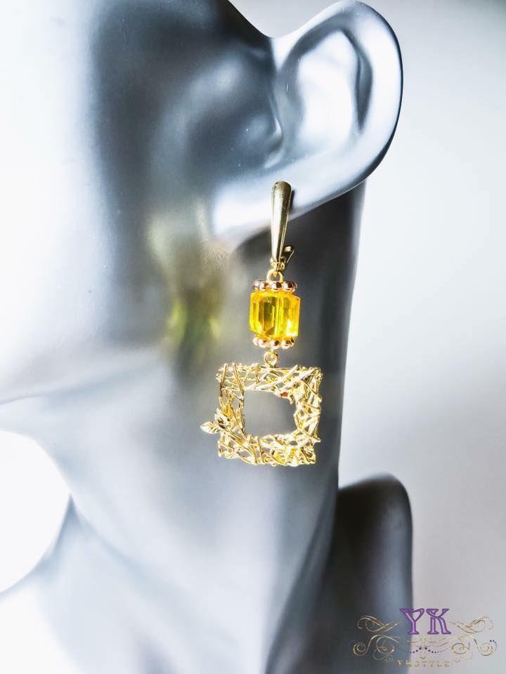 Позолоченные серьги и кристаллы Сваровски.