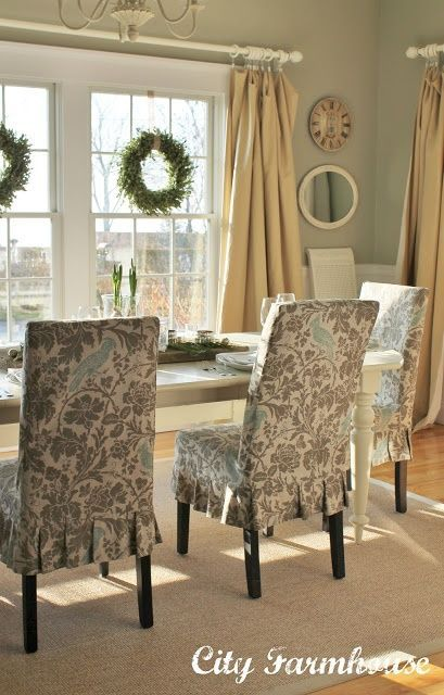 Wall Color: Sprig of Ivy- Lowes Olympic. Slipcover Fabric: Premier Prints/Barber-Eaton Blue Linen. Farmhouse table: Crate and Barrel (discontinued). Rug: Home Goods. Boxwood Wreaths hung with burlap on windows.