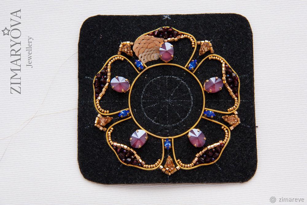 the original brooch