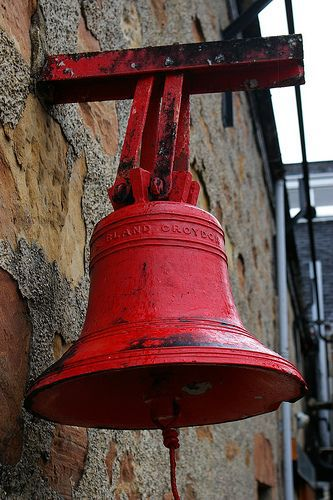 school bell.  My best friend growing up...her family had a bell like this on the side of their house. Her mom would ring it when it was time for her to come home, and we heard it everywhere. I always wanted one to do that for my kids.