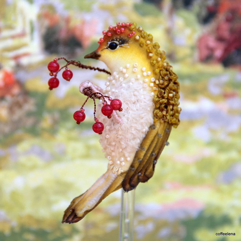 броши птицы