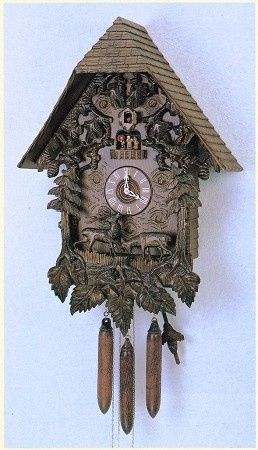 Model #8TMT 1357/9 Large Chalet Cuckoo Clock with Animated Dancing Children.