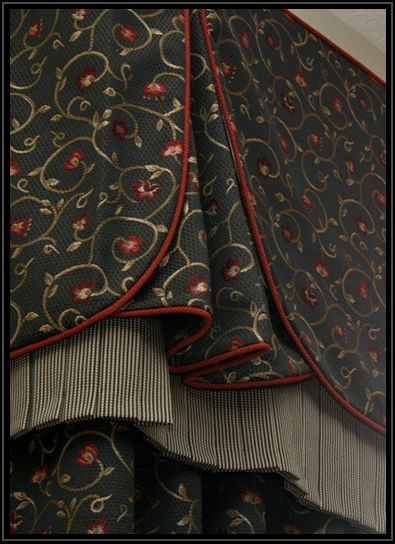 Pure polish with welt detail, pinch pleat vent, box pleat skirt