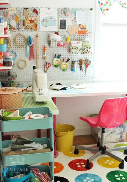 A Sort Of Fairytale: The One About My Craft Room...rug, pink chair, peg board, and aqua rolling cart.
