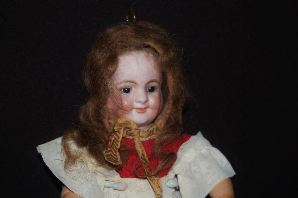 кукла с тремя лицами