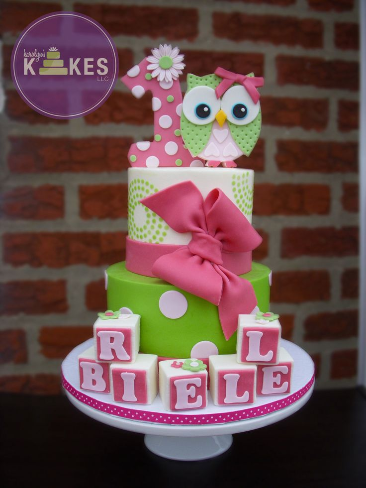 Owl Girl Birthday cake! Cakes iced in buttercream. Marshmallow Fondant polka dots, bow, blocks and toppers. Buttercream stencil on top tier.
