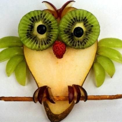 A fruit owl! Pretty self-explanatory. Pear slice for the body, kiwi for the eyes, blueberries for the pupils, green grapes for the wings, cherries or red grapes for the feet and eyebrows. Pretzel stick for the stick. Too cute!