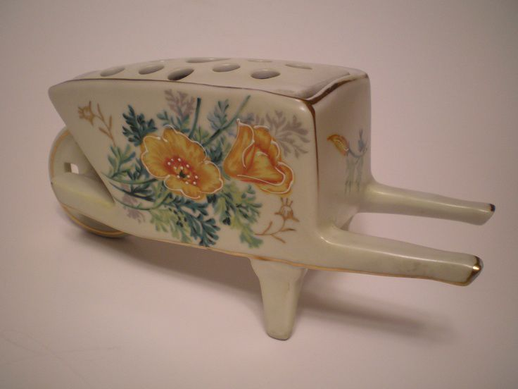 Ceramic Porcelain Wheelbarrow with Flower Frog Yellow Orange Flowers Gold Trim. $19.00, via Etsy.