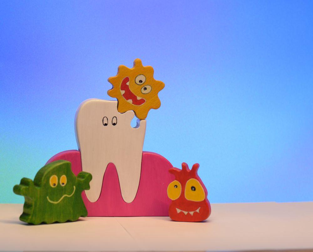 игрушечный зуб