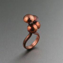 Shiitake Mushroom Copper Ring - Accent your jewelry collection with a look that's made beautiful by nature. This handmade Shiitake Mushroom Copper Ring ring showcases four Shiitake Mushrooms sprouting forth from a tree bark texturized ring shank that is simply enchanting.