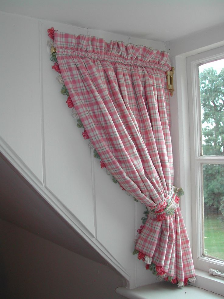 Curtains on a swing arm for dormer window.