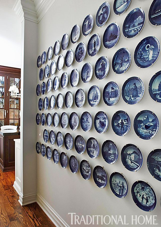 A great collection of blue-and-white plates is displayed in an eye-catching formation. - Traditional Home ® / Photo: Werner Straube / Design: Megan Winters