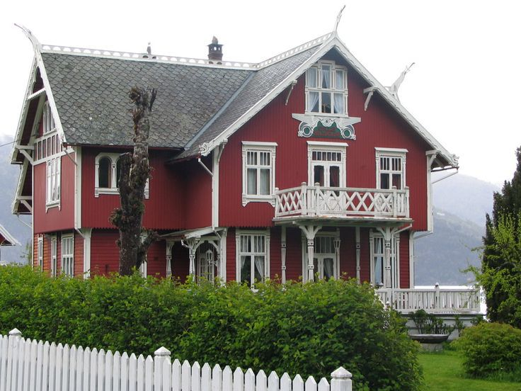 a red house with traditional Norwegian wood work - Balestrand, NO